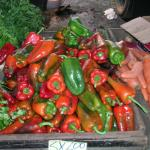 Figure 3. Green and red bell peppers for sale at a wholesale market in San Jose Costa Rica in 2004. Photo by Frank Mangan)