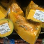 Figure 4. Calabaza cut up and wrapped in plastic on a shelf at a Latino market in Brooklyn New York in 2014. Photo by Frank Mangan)