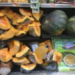 Figure 1. Calabaza, both whole and cut up and wrapped in plastic, for sale at a market in San Juan Puerto Rico in 2016. Photo by Frank Mangan)