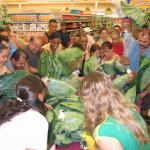 Figure 21. Brazilian customers rush the table where crops popular among Brazilians, grown at the UMass Research Farm, are available for sale at a market in Ashland Mass in 2008. (Photo by Frank Mangan)