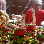 Figure 3. Ají chay (right) next to aji cachucha at a market in Havana Cuba in 2003 (Photo by Frank Mangan)