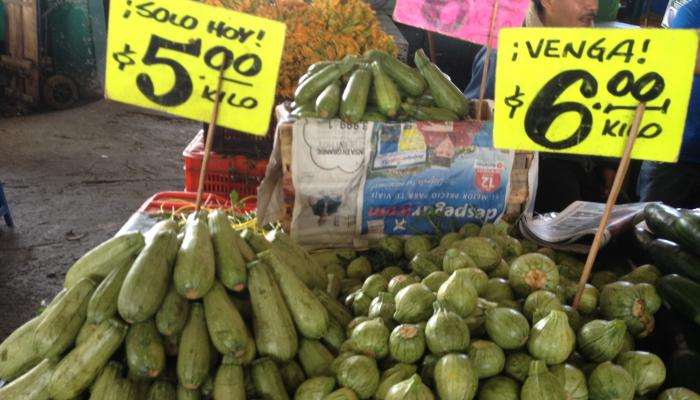 "Two types of calabacita, ""long"" type (left) and ""round"" type (right) at a wholesale market in Mexico City in 2010. (Photo by Frank Mangan)"