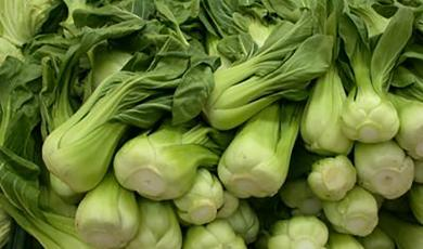 Bok choy for sale at market in Chinatown, New York City (Photo by Frank Mangan)